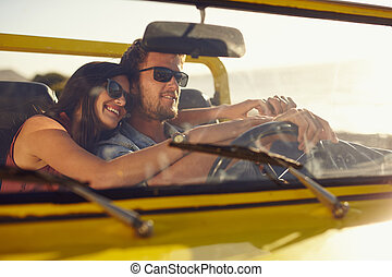 Romantic young couple going on a long drive - Portrait of...