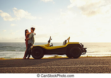 Romantic road trip in nature - Young couple in love...