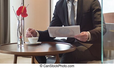 Business man reading documents in meeting room - Successful...
