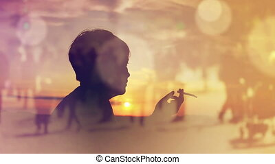 Woman Smoking Cigarette in Sunset - Silhouette of a Woman...
