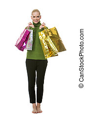 woman with bags - blonde smiling woman carrying gift bags...