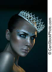 Ice Queen - Model with silver glitter makeup wearing tiara....