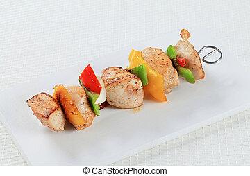 Chicken Shish kebab on a cutting board