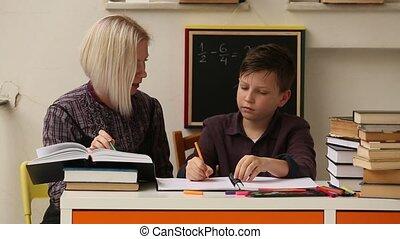Tutor teaches a schoolboy before exams.