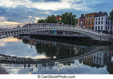 Bridge in Dublin - Evening view of famous HaPenny Bridge in...