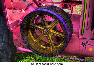 HDR image of the side of a vintage farm tractor.