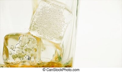 close-up pouring whiskey on white