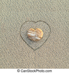 Heart shaped pebble on the beach