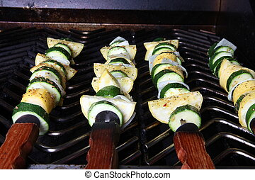 Kabobs - This is a photograph of several kabobs cooking on...