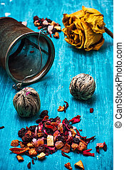 tea brew - dried fragrant tea leaves on wooden turquoise...
