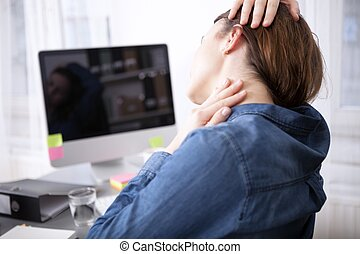 Rear View of Tired Office Woman Massaging her Neck - Close...