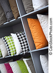 Cushions - Close up of decorative cushions on wooden shelves