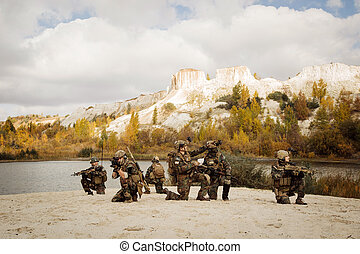 Soldiers takes a break on a berm during patrol the area -...
