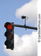 Traffic light - Red traffic light with sensor against cloudy...