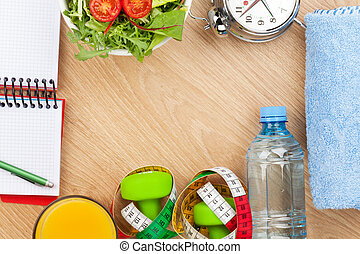 Healthy food, dumbells, tape measure and notepad for copy...
