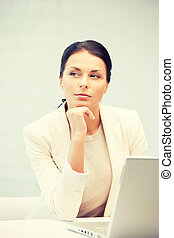 pensive woman with laptop computer - picture of pensive...