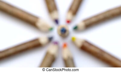 Wooden pencil from branchesare spinning on a white...