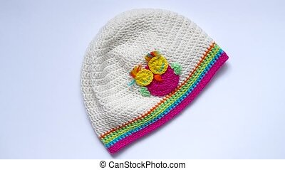 Girls Crochet hat are rotated on the table.