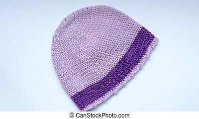 Girls Crochet hat - Violet crochet hat rotates on the table...