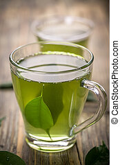 Green tea - Cup with green tea and green leaves