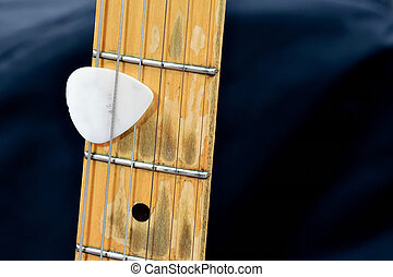 guitar and plectron - the neck from an electric guitar....