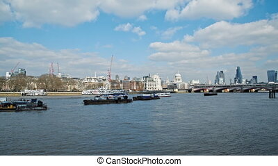 Boats on River thames and skyline - boats travel on river...