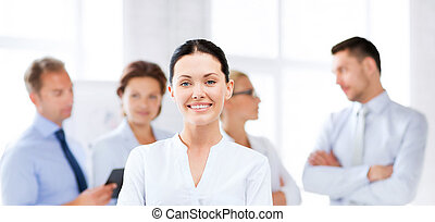businesswoman in office - picture of smiling attractive...