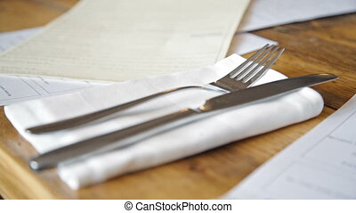 cutlery on wood table in restaurant