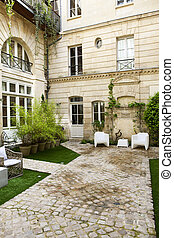 Courtyard - Plants and garden furniture in the courtyard of...
