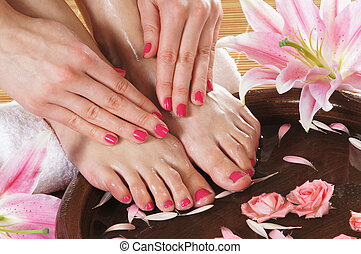 Spa background with a beautiful legs, flowers, petals and...