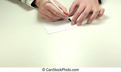 Short written advice Thanks - Adviser%u2019s hands writing...
