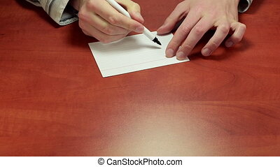 Short written advice 150% - Adviser%u2019s hands writing the...