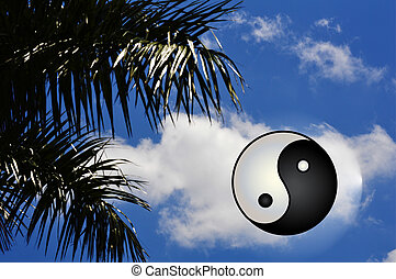 Yin Yang symbol of harmony on blue vivid sky background