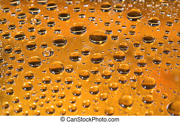 yellow water droplets background .close up