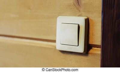 Switch on the wall. Turning off the light. - Man turns off...