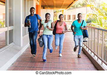 african college students running - cheerful african college...