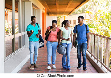 group of college students walking to lecture hall - group of...
