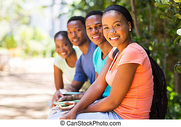 group of african american friends looking at the camera -...