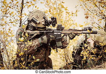 Soldiers team aiming at a target of weapons - US Rangers...