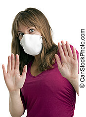 scared young woman wearing a protective mask to protect her...