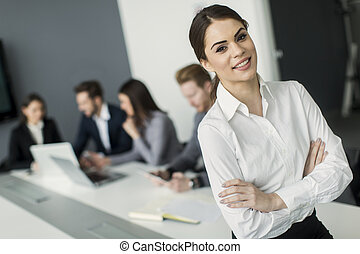 Young woman in the office - Pretty young woman in the office