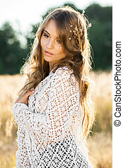 Beautiful young lady model standing in field at sunset -...