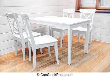 Wooden white dining table and four chairs