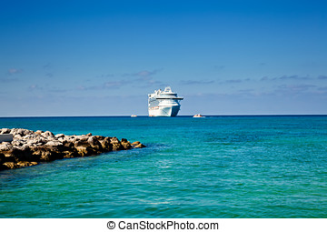 Cruise Ship Anchored on Tropical Island