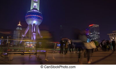 Shanghai night crowd timelapse - Pudong district activity,...