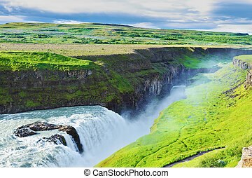 Grandiose Gullfoss in Iceland In July raging water is shined...