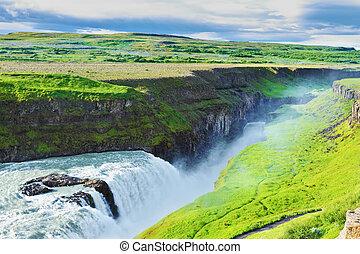 Grandiose Gullfoss in Iceland. In July raging water is...
