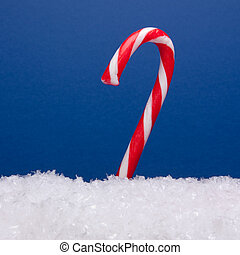 Candy Cane - Striped candy cane on bed of snow Artificial...