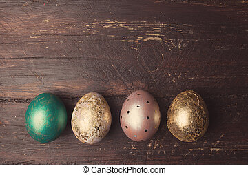 Easter eggs on rustic wooden table. Holiday background....
