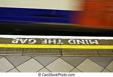 """Mind the gap - Famous \""""mind the gap\"""" notice in the London..."""